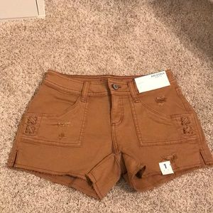 Brown distressed jean shorts